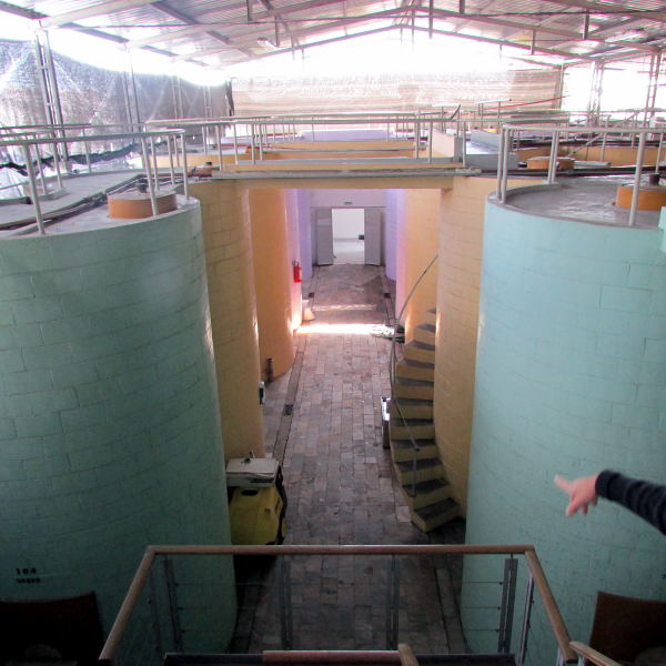 pastel painted tanks at old Carrau winery in Colón